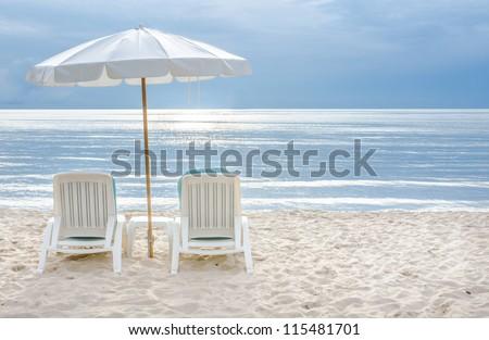 Beach chair on sand beach - stock photo
