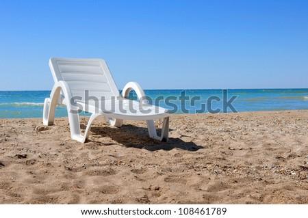 Beach chair on the sand - stock photo