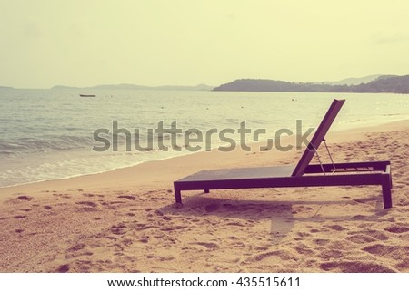 Beach chair on tropical beach in Samui island in Thailand with retro filter effect - stock photo