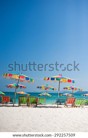 Beach chair under the umbrella of colorful on the beach Phuket, Thailand