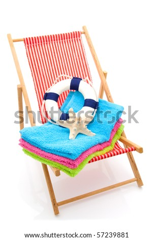beach chair with colorful towel and life buoy over white background - stock photo