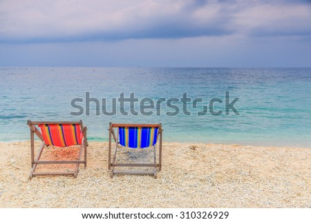 Beach chair with sea and sky background