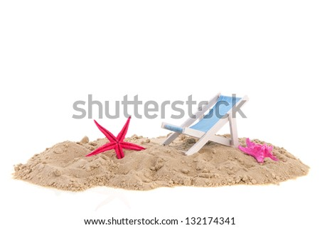 Beach chair with starfishes in the sand