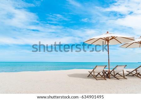 Beach Chair With Umbrella With Blue Sky On Tropical Beach.