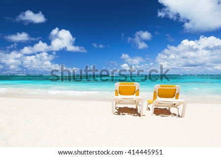 Beach chairs and beautiful sand beach in Punta Cana, Dominican Republic - stock photo