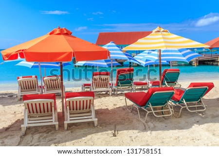 Beach chairs and parasols on a beach in a tropical paradise