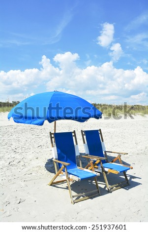 Beach chairs and Umbrella - stock photo