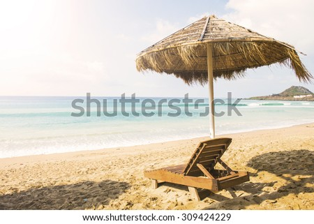 Beach chairs and umbrella on a beautiful panoramic beach view
