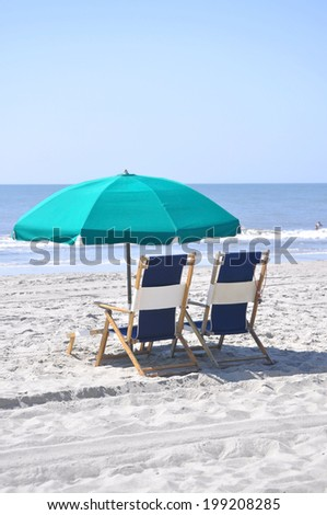 beach chairs and umbrella on the baech - stock photo