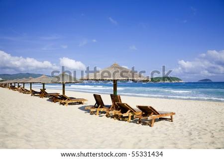 Beach Chairs and Umbrellas - stock photo