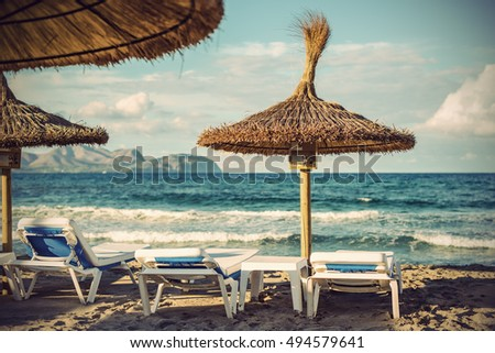 Beach chairs and umbrellas on Can Picafort Beach, Majorca (Mallorca), Balearic Islands, Spain, Europe, Vintage fitlered style