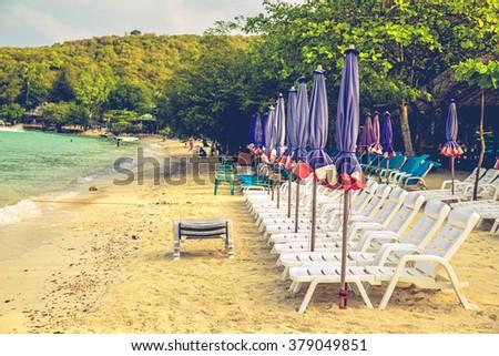 Beach chairs and with umbrella on the beach koh larn pattaya - stock photo