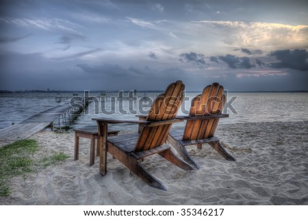 Beach chairs at dusk, HDR - stock photo