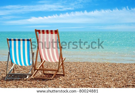 beach chairs at the ocean