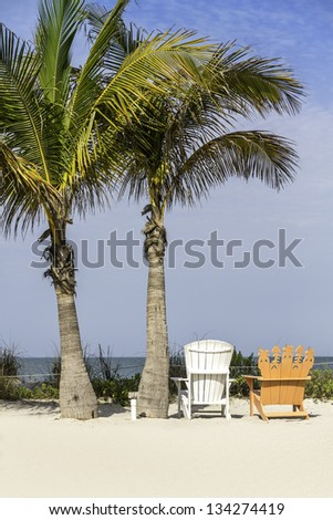 Beach chairs by the ocean in South Florida - stock photo