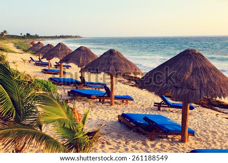 Beach chairs in luxury resort on carribean coast, Mexico - stock photo