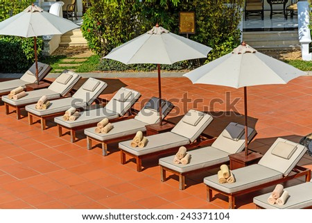 Beach Chairs Near Swimming Pool In Hotel