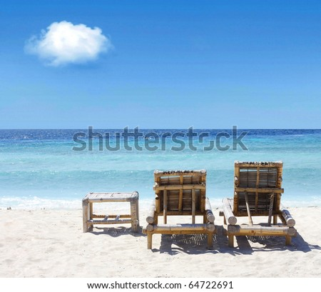 Beach chairs on beach - stock photo