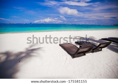 Beach Chairs on beautiful island in white sand plage - stock photo