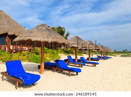 Beach chairs on carribean coast, Mexico - stock photo