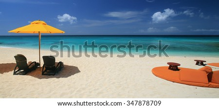 Beach chairs on exotic tropical white sandy beach pf Boracay island,Philippines - stock photo