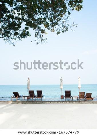 Beach chairs on perfect tropical white sand beach - stock photo