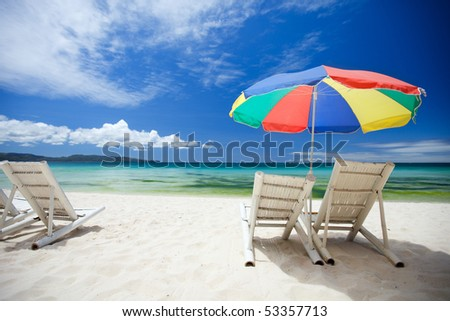 Beach chairs on perfect tropical white sand beach - stock photo