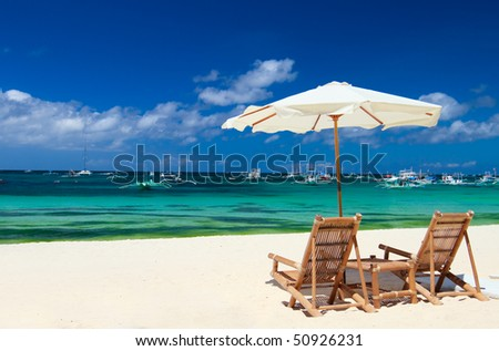 Beach chairs on perfect tropical white sand beach in Boracay, Philippines - stock photo