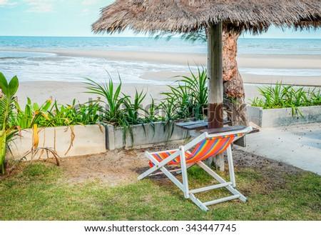 Beach chairs on sea coast at thailand. - stock photo
