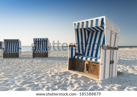 Beach - chairs on the island Sylt on late afternoon. Germany. - stock photo