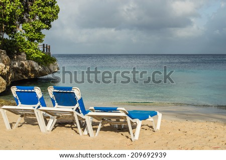 Beach chairs overlooking the ocean - stock photo