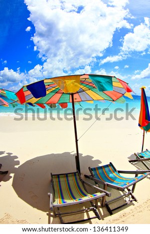 Beach chairs with umbrella and beautiful beach.Khai Island Phuket