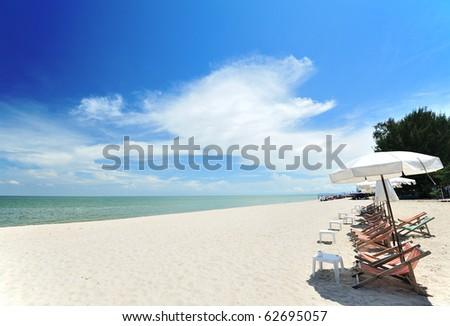 Beach chairs with umbrellas - stock photo