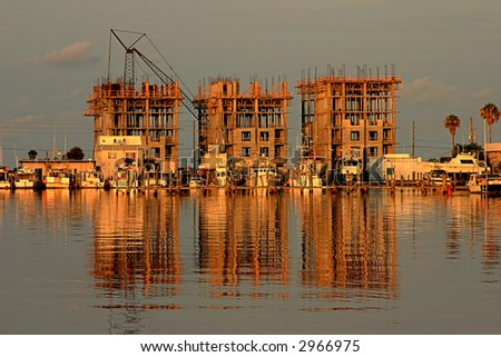 Beach Condo Construction on Florida Gulf Coast in early morning light. - stock photo