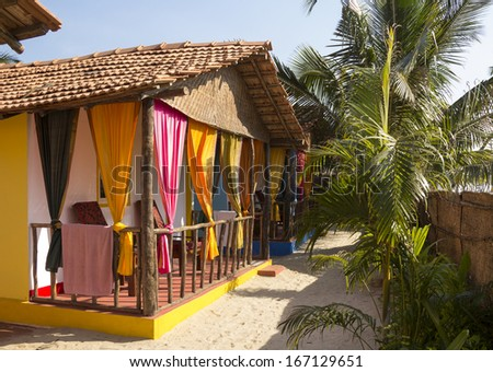 Beach cottages at the hotel on the coast. - stock photo