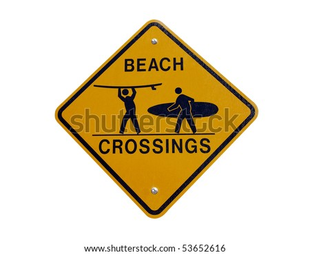 Beach crossing warning sign along a busy Southern California bike route. - stock photo