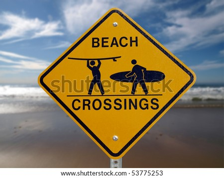 Beach Crossings crosswalk sign with a Malibu beach background. - stock photo