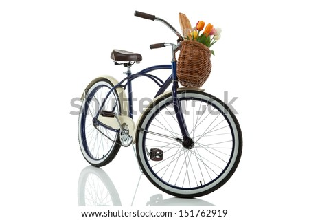 Beach cruiser with basket that has tulips - stock photo