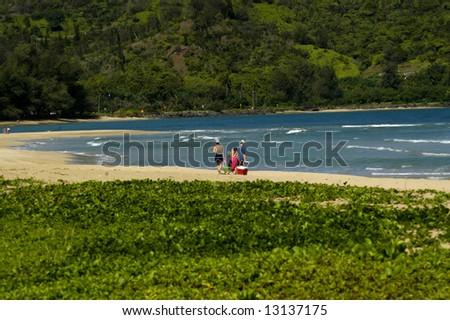 Beach day for family.  Deserted beach with sunshine and blue water.  Kauai, Hawaii. - stock photo