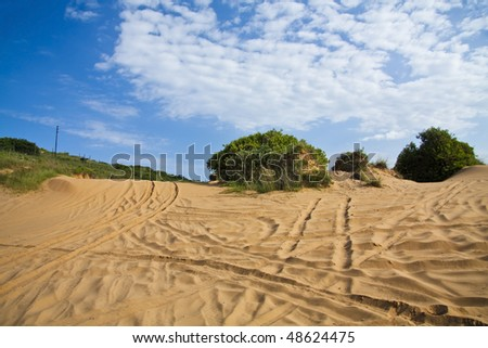 Beach dunes used as a 4x4 trail in Mozambique with a dramatic blue sky (polarised).