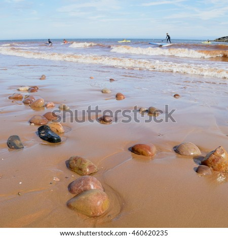 Beach during low tide in Sidmouth, Devon is part of Jurassic Coast which was awarded World Heritage Site status in December 2001 - stock photo