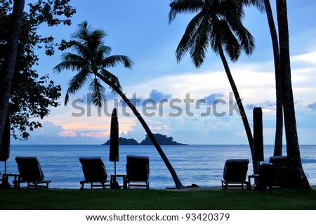 Beach during sunset with coconut palms, Koh Chang island, Thailand - stock photo