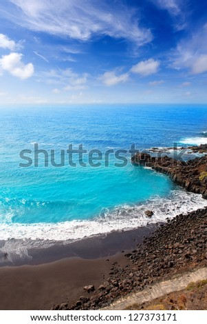 Beach el Bollullo black brown sand and aqua water near Puerto de la Cruz - stock photo