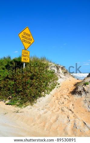 Beach erosion sign on the east coast of florida usa - stock photo