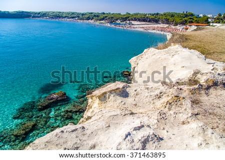 beach facilities on bay near rocky cove on the coast of Salento in Puglia in Italy - stock photo