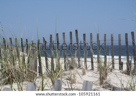 Beach fence - stock photo
