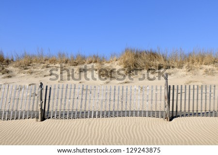 Beach Fence and Sand Dune - stock photo