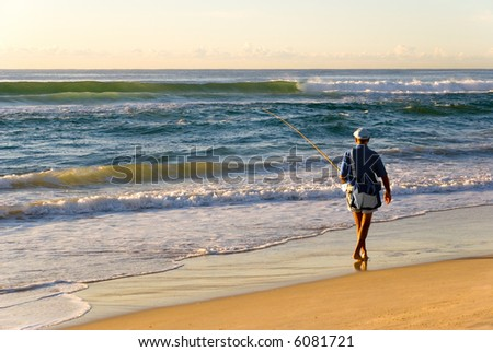 Beach Fisherman fishing in ocean surf
