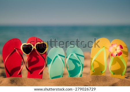 Beach flip-flops on the sand. Summer vacation concept - stock photo