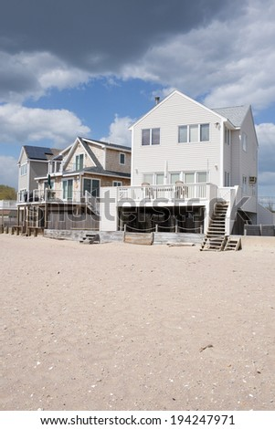 Beach front cottages and homes on Long Island Shore in Old Saybrook, Connecticut. - stock photo